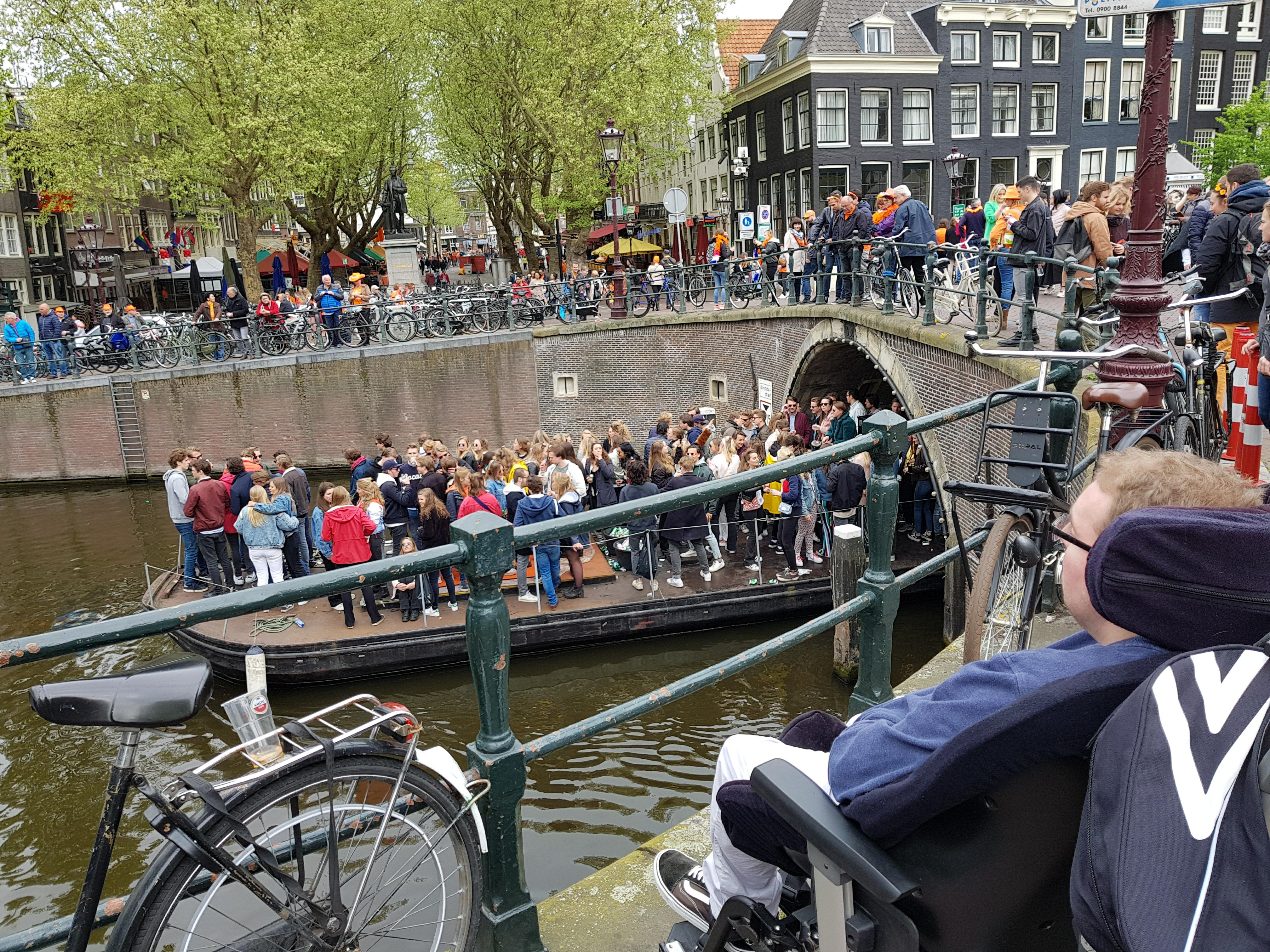 A boat on one of Amsterdam's canals filled with people partying