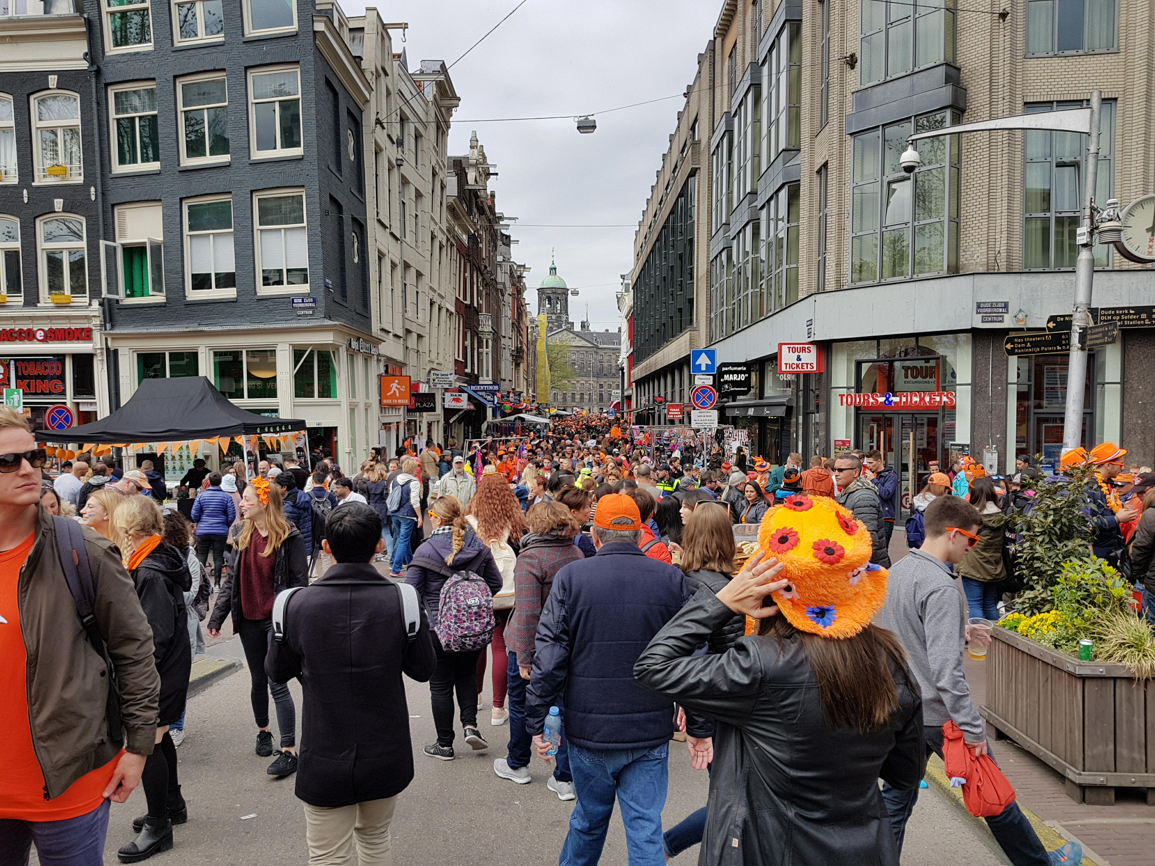 A crowded Street In Amsterdam on King's day